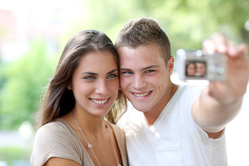Cute young couple of lovers taking picture of themselves