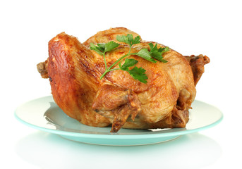 whole roasted chicken with parsley isolated on white