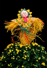 decoration of scarecrow with mum flower