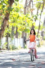 girl riding bike outdoor