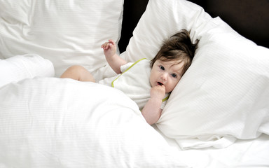 Baby in bed with three pillows