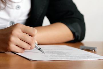 Obraz Woman's hand with pen writing © Nogawczyk Krzysztof - fototapety do salonu
