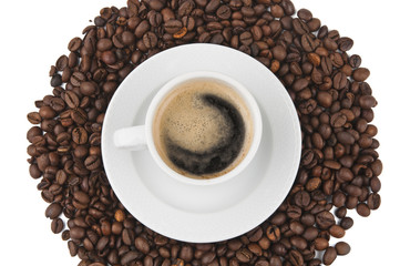Coffee beans and cup of coffee background isolated