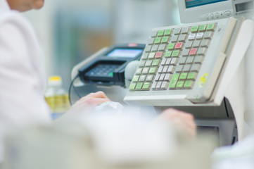 Cash-desk with cashier and terminal in supermarket