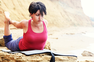 Woman in bow yoga pose