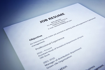 Closeup of resume on blue background