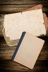 Grungy old book and papers on wood