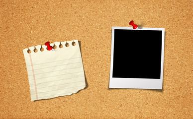 Blank Photo and Notepad with push pin on cork board background