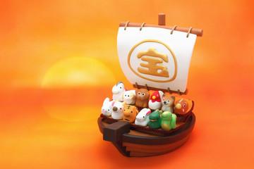 日の出の宝船と可愛い十二支の人形
