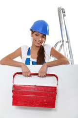 woman with a large toolbox and a board for your image