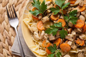 Chicken with noodles and carrots