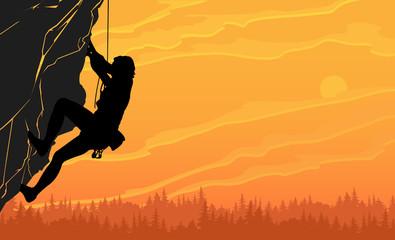 Rock climber on a sunset background