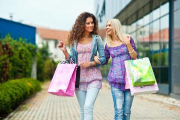 two woman friends shopping