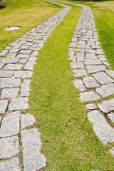 curved cobblestone road