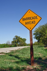 Barricade ahead warning sign