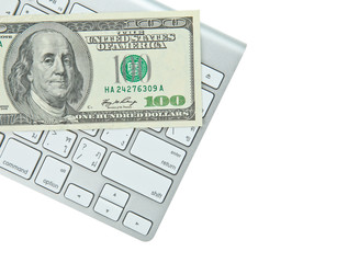 Keyboard and bank note money isolated on white background