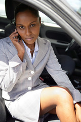 businesswoman in a car talking on her cell