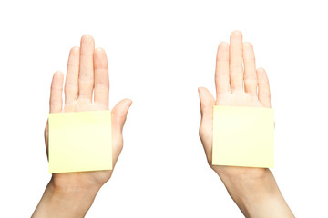 Human hands with yellow blank stickers