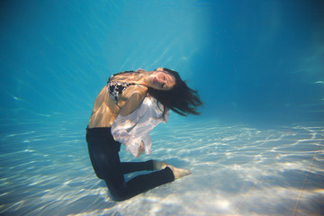 Woman wearing a jeans underwater