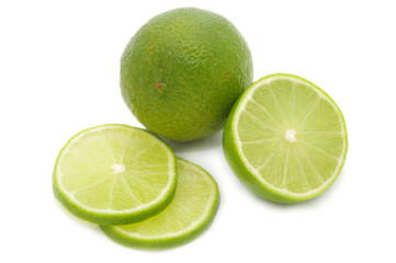 Lime and its slices isolated on white