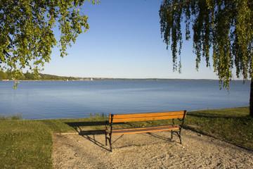 Beach of Balatonkenese with a bench