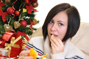 Woman with christmas mandarin