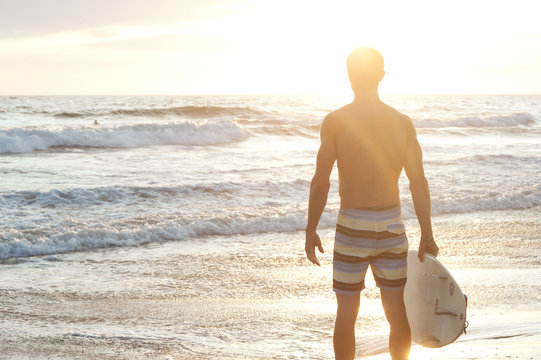 portrait of a surfer on the beach