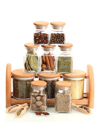 Poster Kruiden 2 jars and wooden with spices isolated on white