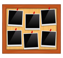 Photo frames on bulletin board