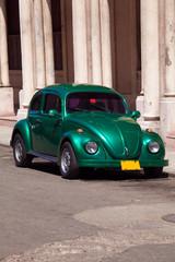 Vintage green car on the street of old city, Havana, Cuba