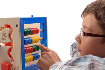 Obraz Boy learns mathematics - fototapety do salonu