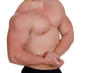 Young muscular man over white background