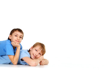 Two boys posing lying