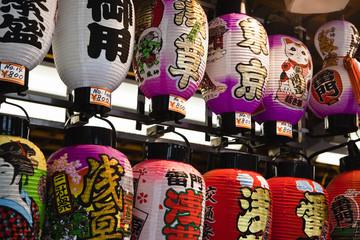 tokyo: japanese paper lanterns sold at street market