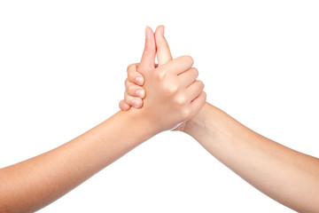 two hands teenager, holds his thumb up. Teamwork. Symbol for suc
