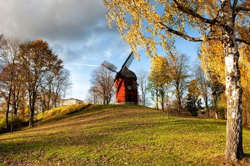 Old windmill during autumn in Sweden