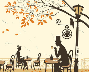 Autumn cafes and romantic relationship between man and woman