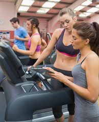 Female Instructor and woman in the gym