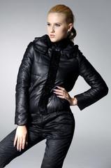 High fashion model in modern dress posing gray background