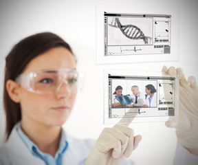 Lab technician selecting medical image from hologram interface