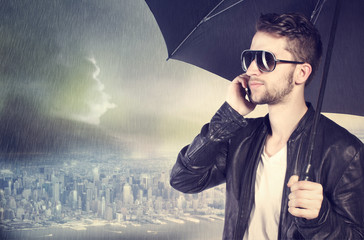 Man talking on his cellphone in the rain