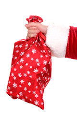 Santa Claus hand holding bag of gifts isolated on white