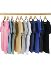 Choice of man clothes of different colors on wooden hangers