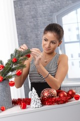 Smiling beauty decorating for christmas