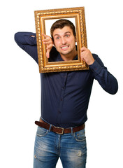 A Young Man Holding And Looking Through Frame