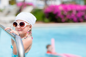 Little girl at swimming pool