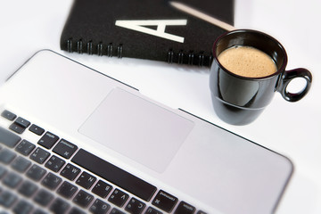 Laptop (notebook) with cup of coffee and notepad
