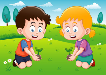 Little kids is planting small plant in garden
