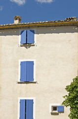 House , blue shutter in French Village, Provence.