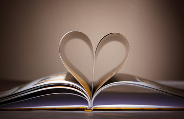 Pages curved into a heart shape